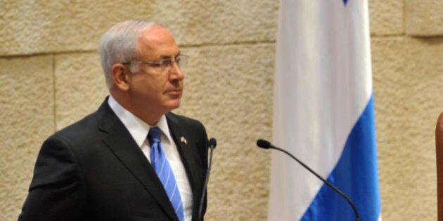 French President Nicolas Sarkozy (R) listens to Israeli opposition leader Benjamin Netanyahou (L) delivering...
