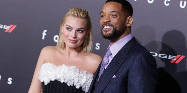 Will Smith, left, and Margot Robbie arrive at the world premiere