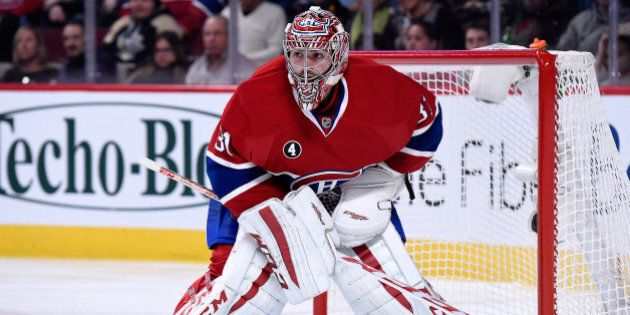 MONTREAL, QC - JANUARY 10: Carey Price #31 of the Montreal Canadiens watches play during the NHL game against the Pittsburgh Penguins at the Bell Centre on January 10, 2015 in Montreal, Quebec, Canada. The Penguins defeated the Canadiens 2-1 in overtime. (Photo by Richard Wolowicz/Getty Images)