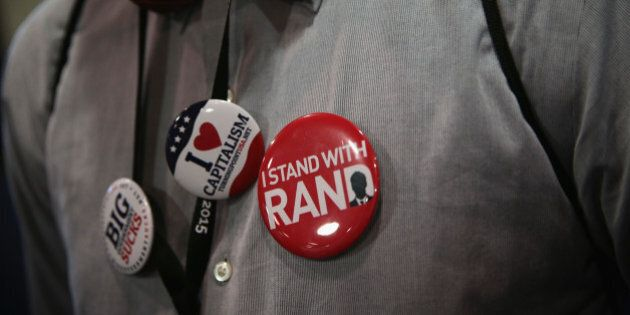NATIONAL HARBOR, MD - FEBRUARY 28: An attendee wears pins in support of U.S. Sen. Rand Paul (R-KY) during...