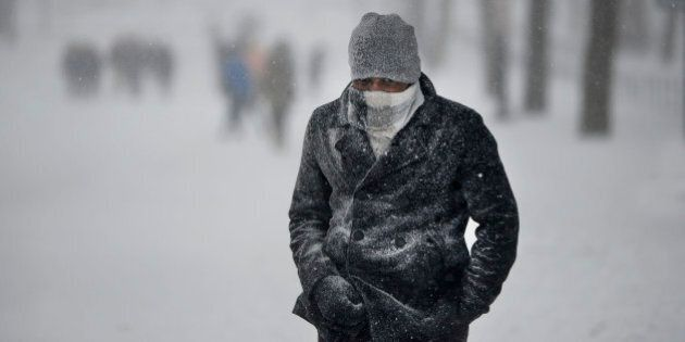A man walks on Constitution avenue during a major storm on January 23, 2016 in Washington.A deadly blizzard with bone-chilling winds and potentially record-breaking snowfall slammed the eastern US on January 23, as officials urged millions in the storm's path to seek shelter -- warning the worst is yet to come. US news reports said at least eight people had died by late Friday from causes related to the monster snowstorm, which is expected to last until early Sunday. / AFP / Olivier Douliery        (Photo credit should read OLIVIER DOULIERY/AFP/Getty Images)