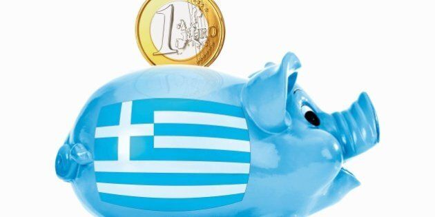 Piggy bank with 1 euro coin and greek