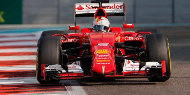 Ferrari driver Sebastian Vettel of Germany steers his car during the third free practice at the Yas Marina...