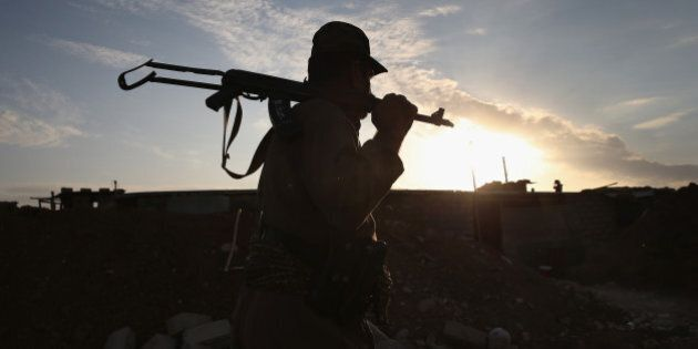 TELSKUF, IRAQ - NOVEMBER 05: A Kurdish Peshmerga soldier mans an observation post on the frontline with...