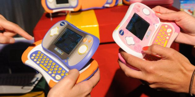 COMMERCIAL IMAGE - VTech Electronics unveiled the new MobiGo 2 Touch Learning System at a VTech event...
