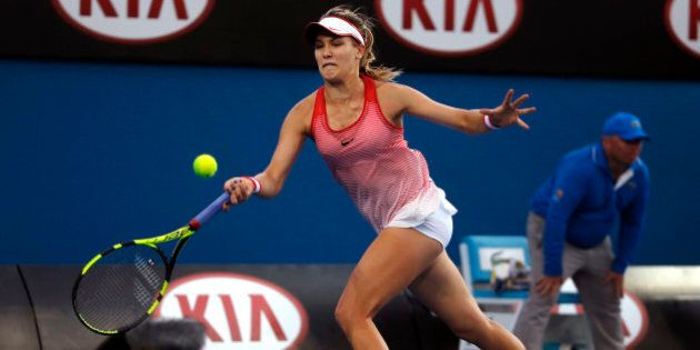 Eugenie Bouchard of Canada makes a forehand return to Aleksandra Krunic of Serbia during their first...