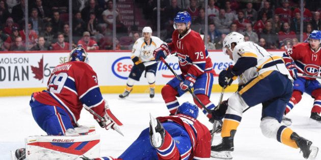 MONTREAL, QC - FEBRUARY 22: Mike Condon #39, Andrei Markov #79 and P.K. Subban; of the Montreal Canadiens...