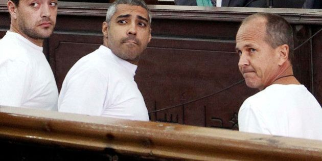FILE - In this Monday, March 31, 2014 file photo, Al-Jazeera English producer Baher Mohamed, left, Canadian-Egyptian...