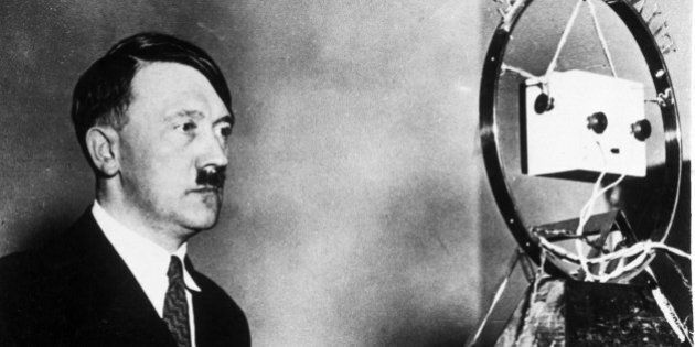 GERMANY - NOVEMBER 29: Adolf Hitler, c 1931. ' Hitler in front of a microphone. (Photo by Daily Herald...