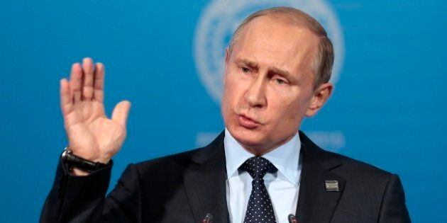 Russian President Vladimir Putin gestures while speaking at a news conference after the Shanghai Cooperation...