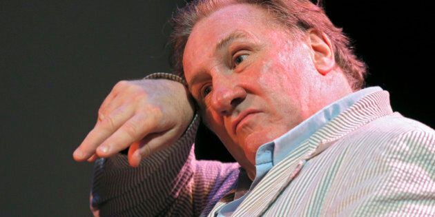 French actor Gerard Depardieu dries his head as he attends the first Russian Film Festival in Nice,southern...
