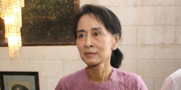 Myanmar Opposition Leader Aung San Suu Kyi arrives for a ceremony to mark one month anniversary of the...