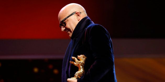 Gianfranco Rosi, director of 'Fuocomare', is awarded a Golden Bear for Best Film, during the award ceremony...
