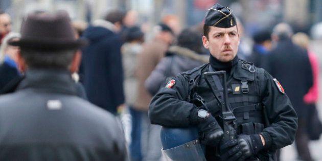 A riot police officer patrols on the Place de la Republique in Paris, Friday, Nov. 27, 2015. A subdued...