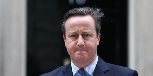 British Prime Minister David Cameron makes a statement to the media outside 10 Downing Street in London...