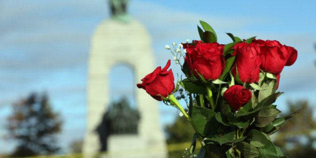 OTTAWA, ON- OCTOBER 23  -   Flowers are placed on the barrier near the War Memorial in the aftermath of a shooting in Ottawa, where a soldier murdered at the War Memorial and a gun battle in Parliament killed the alleged gun man. in Ottawa. October 23, 2014.        (Steve Russell/Toronto Star via Getty Images)
