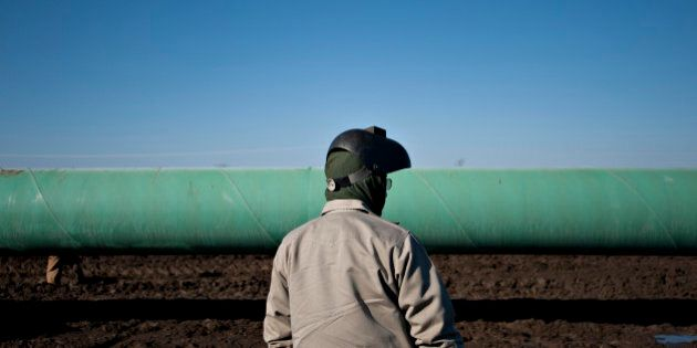 Welder Jerry Smith waits for a weld shack to be moved during construction of the Gulf Coast Project pipeline...