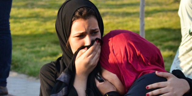 Egyptian women mourn for victims of a passenger boat after it sunk in the river Nile in Giza, south of...
