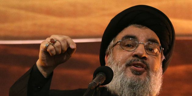 FILE - In this November 3, 2014, file photo, Hezbollah leader Sheikh Hassan Nasrallah addresses supporters...