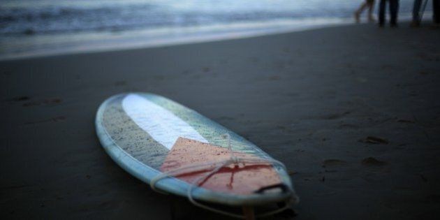A picture taken on December 23, 2014 shows a surfboard decorated with a Palestinian flag on the beach...