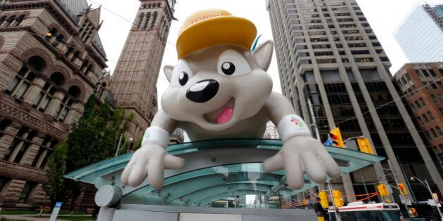 Pachi, the mascot for the Pan Am Games, is displayed on a bus stop in downtown Toronto, Thursday, July 9, 2015. The city will host the games starting with Friday's opening ceremony. (AP Photo/Julio Cortez)