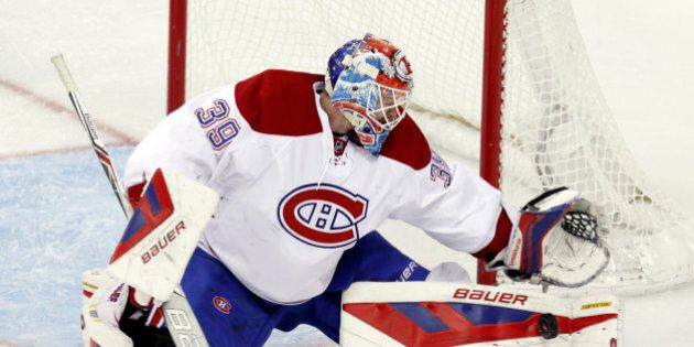 Montreal Canadiens' Mike Condon stops a shot against the Columbus Blue Jackets during an NHL hockey game...