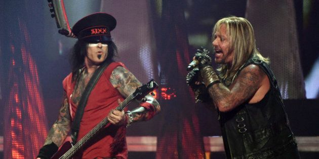 LAS VEGAS, NV - SEPTEMBER 19: Bassist Nikki Sixx (L) and singer Vince Neil of Motley Crue perform during...