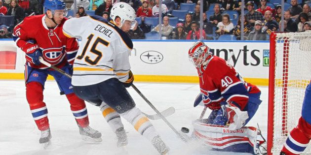 BUFFALO, NY - FEBRUARY 12: Ben Scrivens #40 of the Montreal Canadiens makes a save against Jack Eichel...
