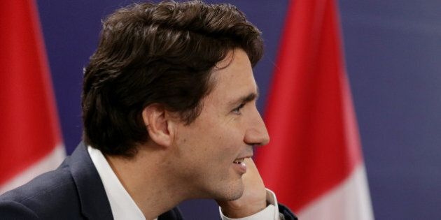 Canadian Prime Minister Justin Trudeau listens to a question from the floor during a press conference...