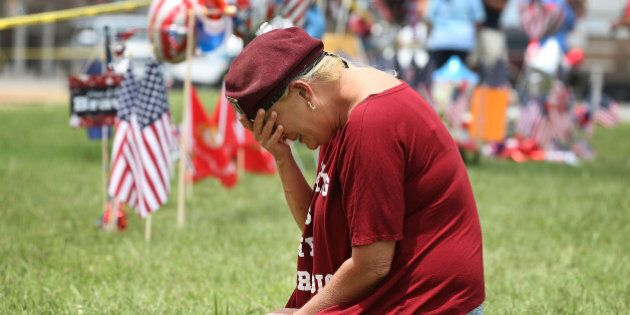 CHATTANOOGA, TN - JULY 17: Laurie Norman is overcome with emotion as she pays her respects to those killed...