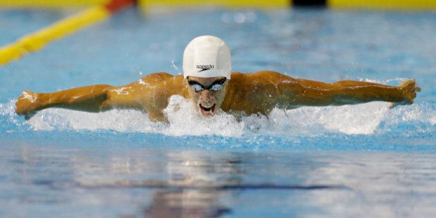 Mauricio Fiol of Peru competes during the finals of the men's 200-meter butterfly swimming event at the...