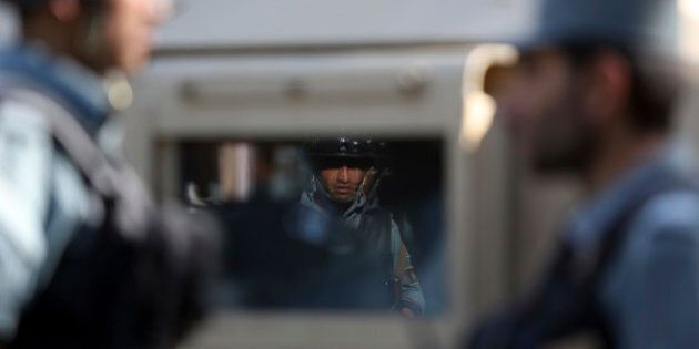 Afghan security officers patrol an area that came under an overnight attack, in Kabul Afghanistan, Wednesday,...