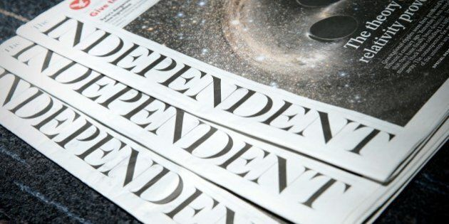 Copies of the British newspaper 'The Independent' are arranged for a photograph in London on February...