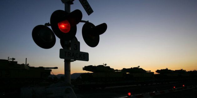 DAGGETT, CA - JUNE 16: A train that runs along old Route 66 transports military tanks on June 16, 2007...