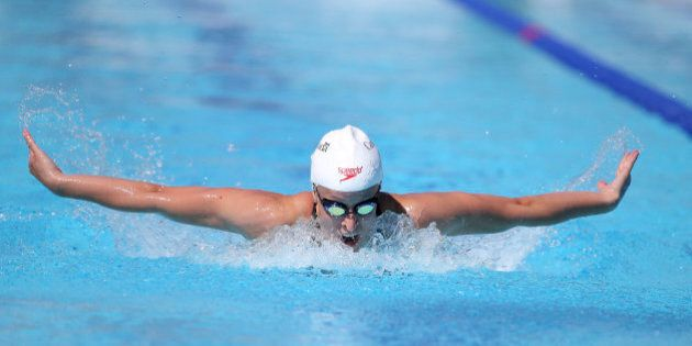 Canada's Katerine Savard swims during her women's 200-meter butterfly heat at the Pan Pacific swimming championships in Gold Coast, Australia, Thursday, Aug. 21, 2014. (AP Photo/Rick Rycroft)