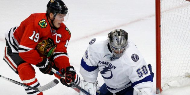 Chicago Blackhawks center Jonathan Toews (19) scores a game winning goal past Tampa Bay Lightning goalie...