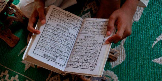 Student reading the Koran in an Islamic school, New Delhi,