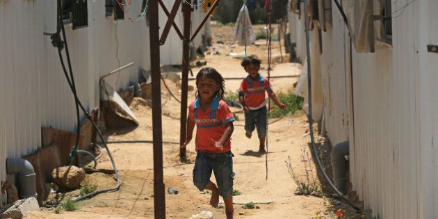 GAZA CITY, GAZA - JUNE 11: Young children run beytween their temporary 'container' homes in the village...