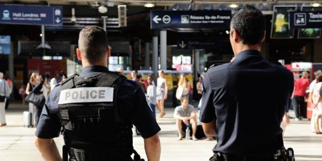 French police officers patrol at Gare du Nord train station in Paris, France, Saturday, Aug. 22, 2015....