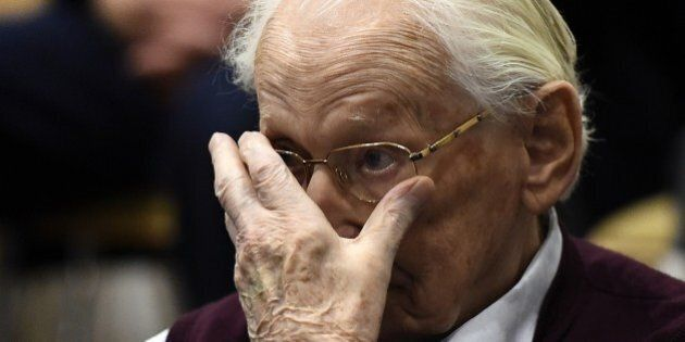 Convicted former SS officer Oskar Groening listens to the verdict of his trial on July 15, 2015 at court...