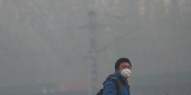 SHENYANG, CHINA - NOVEMBER 08: (CHINA OUT) A man wearing a mask walks in the smog on November 8, 2015...