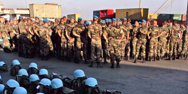 French U.N. peacekeepers' belongings and blue helmets lie at the dock as troops wait for military vehicles and equipment to get unloaded from the French chartered cargo ship Fast Arrow that docked at the port of Beirut, Lebanon, Tuesday, Sept. 12, 2006, carrying heavy equipment for French peacekeepers in the U.N. force monitoring the cease-fire between Israel and Hezbollah. France, which currently leads the U.N. peacekeeping mission in Lebanon known as UNIFIL, is expected to increase its contribution to 2,000 soldiers as part of a force of 15,000 that will help the Lebanese army establish authority along the Lebanese-Israeli border. (AP Photo/Alvaro Barrientos)