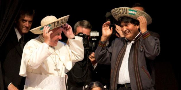 Pope Francis and Bolivia's President Evo Morales, smile as they don the traditional Bolivian hats they...