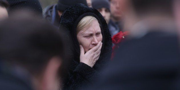 SAINT-PETERSBURG, RUSSIA - NOVEMBER 6 : People attend the funeral ceremony of the Russian plane crash...