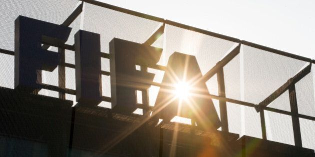 ZURICH, SWITZERLAND - JUNE 03: A FIFA logo sits on the rooftop at the FIFA headquarters on June 3, 2015...