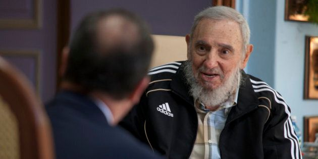 Cuba's leader Fidel Castro, right, talks with French President Francois Hollande at his residency in...