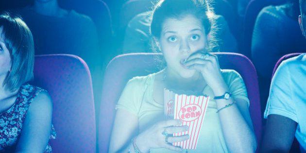 Woman enjoying movie at