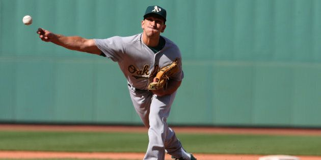 BOSTON, MA - JUNE 7: Pat Venditte #29 of the Oakland Athletics throws in relief in the eighth inning...