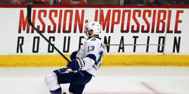 CHICAGO, IL - JUNE 08:  Cedric Paquette #13 of the Tampa Bay Lightning celebrates after scoring the game winning goal against the Chicago Blackhawks during Game Three of the 2015 NHL Stanley Cup Final at the United Center on June 8, 2015 in Chicago, Illinois. The Lightning defeated the Blackhawks 3-2.  (Photo by Jonathan Daniel/Getty Images)