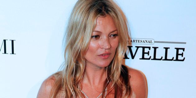 British model Kate Moss poses on the red carpet at a Foundation for AIDS Research (amfAR) event in Sao Paulo, Brazil, Friday, April 10, 2015. (AP Photo/Andre Penner)